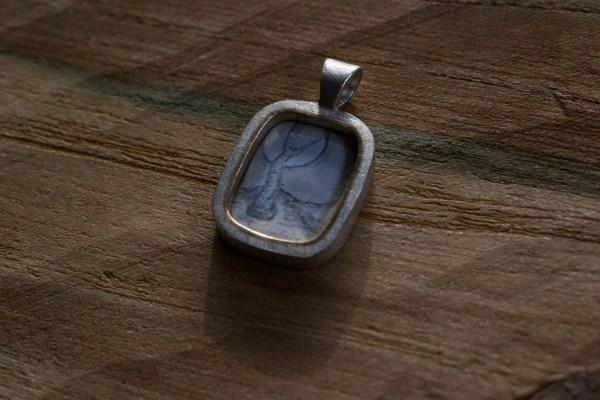 Enamel pendant on wood