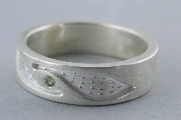 Silver ring with peridot side view