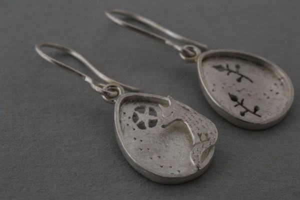 Silver earrings up close