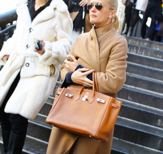 On Right Prada coat Hermès bag