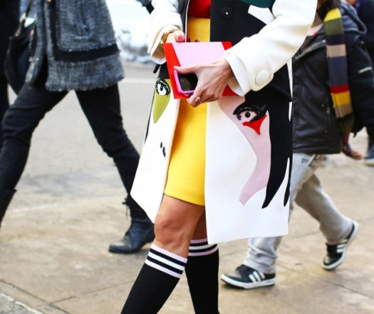 Prada coat, shirt, skirt, and socks; Christian Louboutin shoes