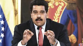 Handout photo released by the Venezuelan Presidency of Venezuelan President Nicolas Maduro speaking during a TV program at Miraflores presidential palace in Caracas on September 2, 2014. Maduro made announcements of changes in his cabinet.  AFP PHOTO / PRESIDENCIA