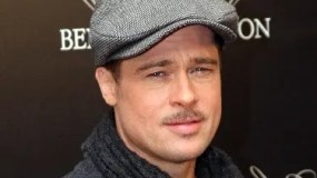 US actor Brad Pitt, stared in The Curious Case of Benjamin Button (L'etrange histoire de Benjamin Button) directed by US David Fincher poses on January 22, 2009 during a photocall in Paris. The film will be released on French screens on February 4, 2009.  AFP PHOTO  PATRICK KOVARIK