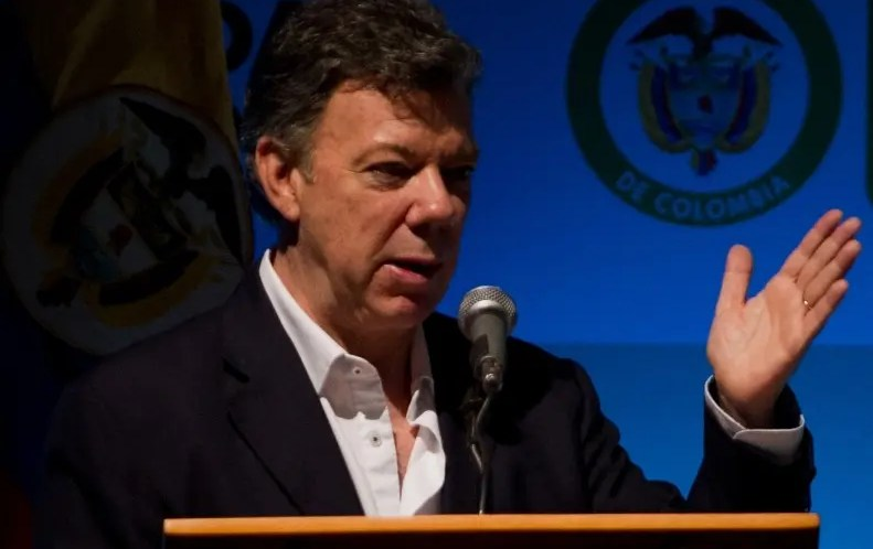 Colombian President Juan Manuel Santos speaks during the opening ceremony of the Americas Competitiveness Forum VI (ACF VI), in Cali, Valle del Cauca department, Colombia, on October 24, 2012.   AFP PHOTO / Luis ROBAYO