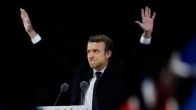 French president-elect Emmanuel Macron waves to the crowd as he delivers a speech at the Pyramid at the Louvre Museum in Paris on May 7, 2017, after the second round of the French presidential election. Emmanuel Macron was elected French president on May 7, 2017 in a resounding victory over far-right Front National (FN - National Front) rival after a deeply divisive campaign, initial estimates showed. / AFP / Patrick KOVARIK