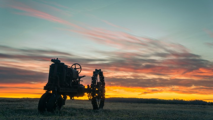 Tractor In the Field At Dawn