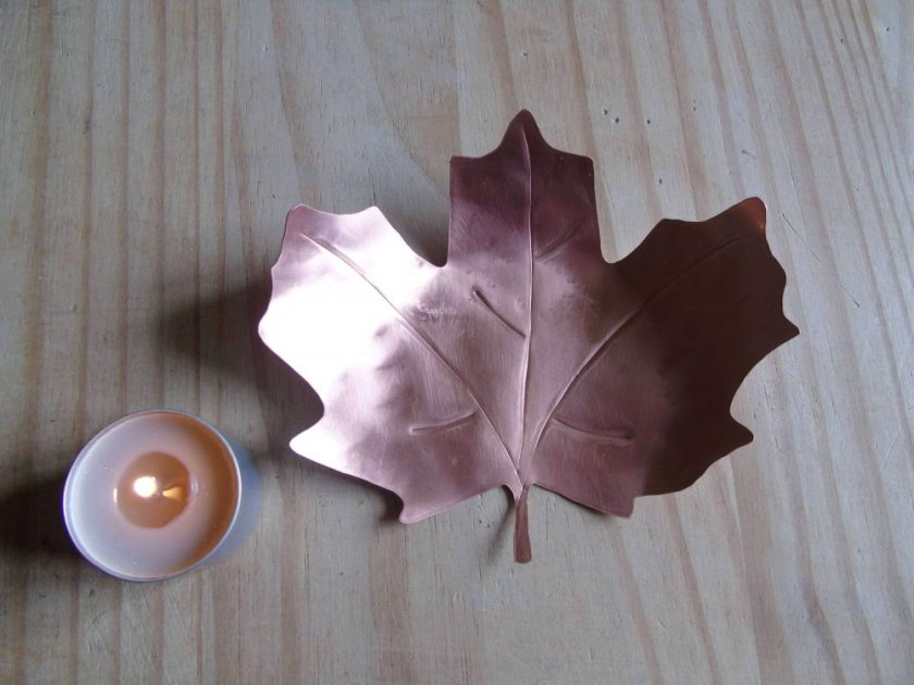 copper leaf shaped tealight holder with tealight at the side