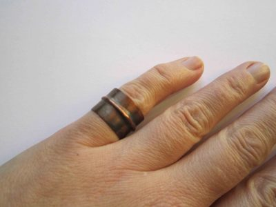 fold formed copper cuff ring being worn