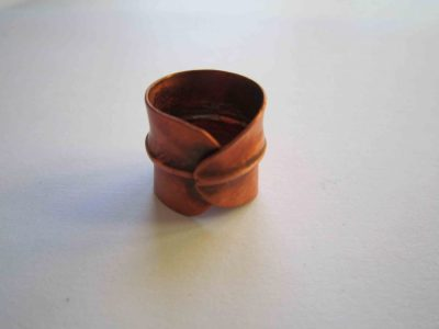 fold formed copper ring with overlap design showing the overlap