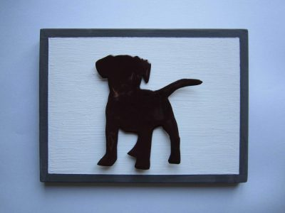 Enamelled puppy on wooden board