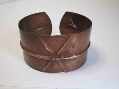 Fold formed cuff bracelet showing signature on inside