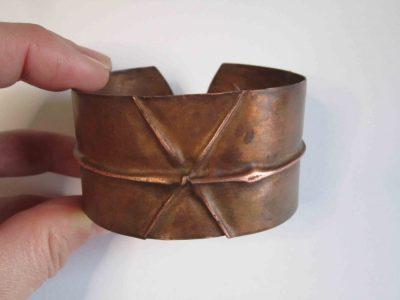 Copper cuff bracelet with fold cross design