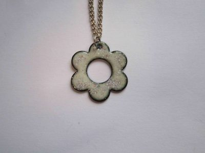 Pale grey/white daisy shaped necklace pendant with speckles