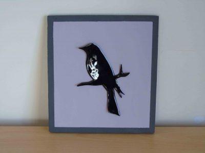 Blackbird on mauve painted wooden board