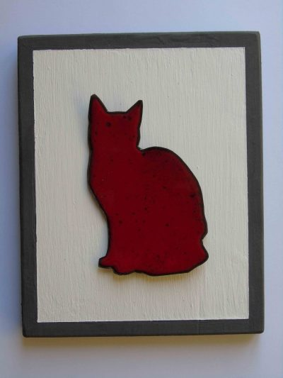 Red enamelled cat wall art