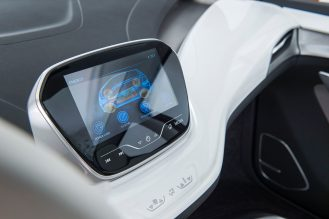 """2015 Chevrolet Bolt EV Concept Interior features unique crossover proportions. A flat, flow-through floor adds to the roominess of the cabin. Slim-architecture seats mounted on exposed aluminum pedestals create a floating effect. The minimalist center console """"floats"""" – suspended from the front seats. Leather wrapped electronic shifter with anodized orange accents adds to the hi-tech feel of interior."""