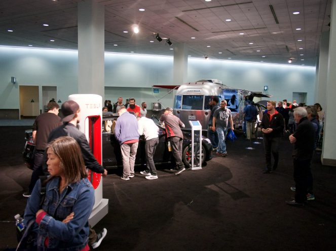 Tesla booth swarmed by onlookers