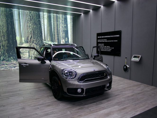 "MINI Countryman Plug-in Hybrid display - ""Charging is optional"" says the wall, isn't the point of getting an EV to make GAS optional? Come on BMW, get with the program."