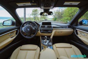 70 interior dashboard navigation system BMW 330e Hybrid 3 series sports sedan review