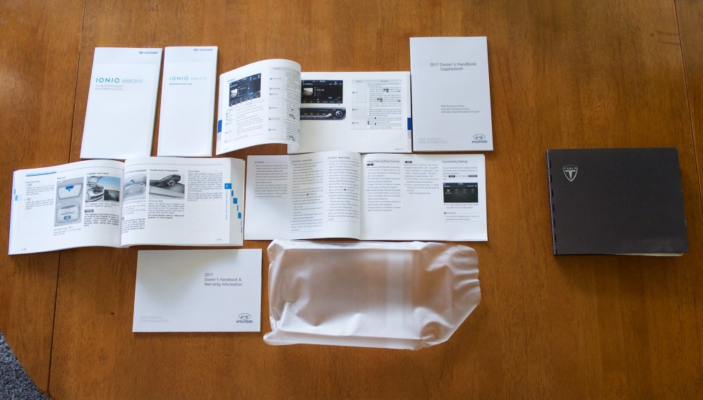 A comparison of Hyundai's manuals (left) and Tesla Roadster's manual (right). The Hyundai does have more features, of course.