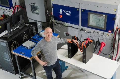 Porter Harris, CTO and Co-Founder with battery test equipment in R&D Lab