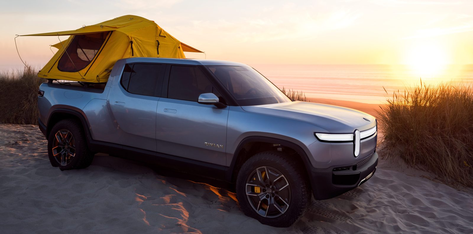 Rivian unveils all-electric pickup truck with unbelievable ...