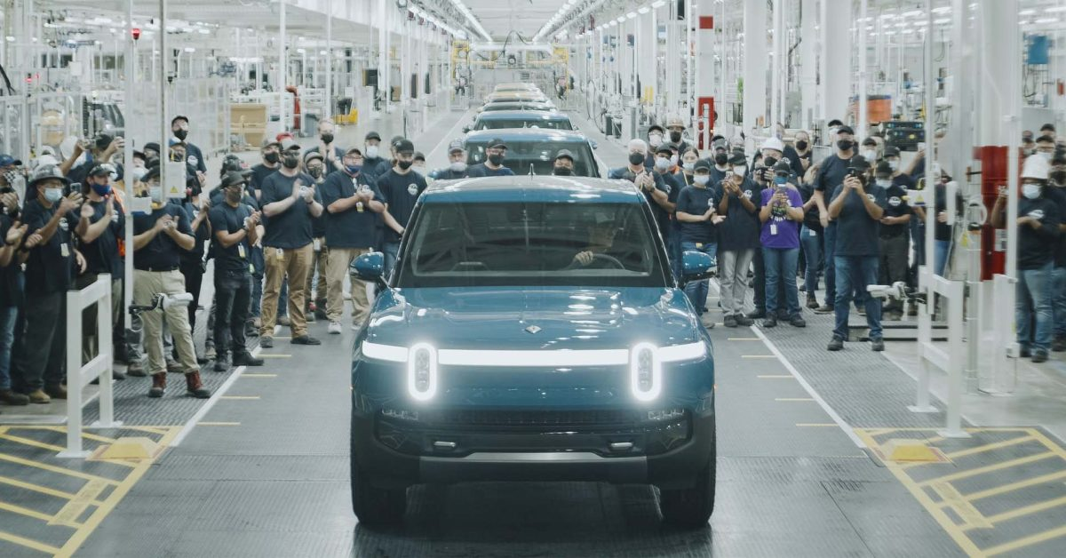 Rivian team watches first customer R1T roll off production line