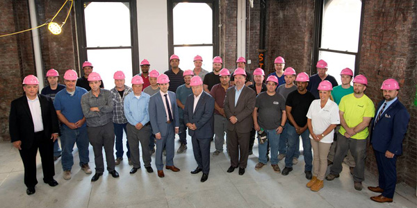 300 Forest Electric New York Construction Workers Wear Pink Hard Hats at Job Sites in October