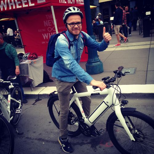 happy electric bike rider