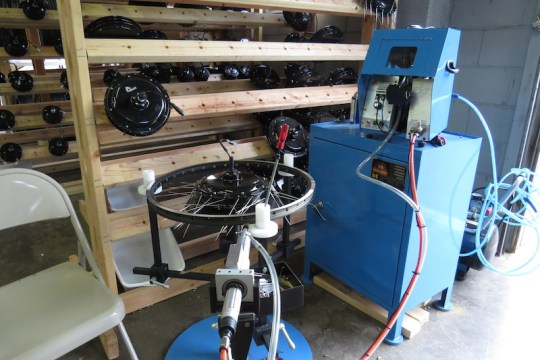 This is the E-BikeKit wheel building machine.