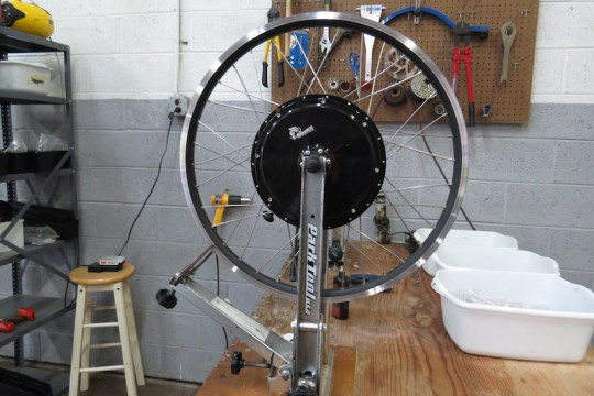 After the wheels are assembled, they are hand tensioned and trued.