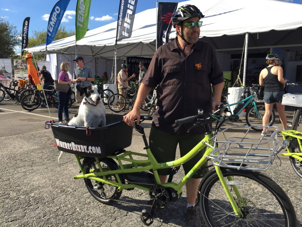 Bixby, her human and their Yuba Spicy Curry electric cargo bike