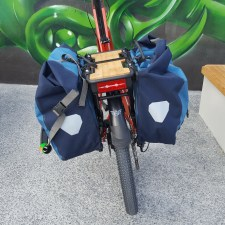 The panniers fit on nicely with a flat space for other things (like pot plants)