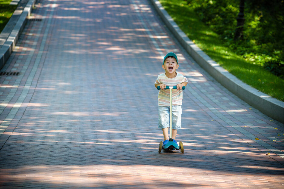 boy rides with a 3-wheel electric scooter