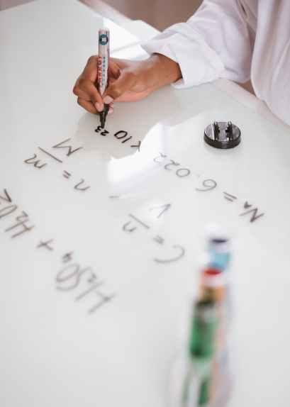 Chemist writing hydrogen formula
