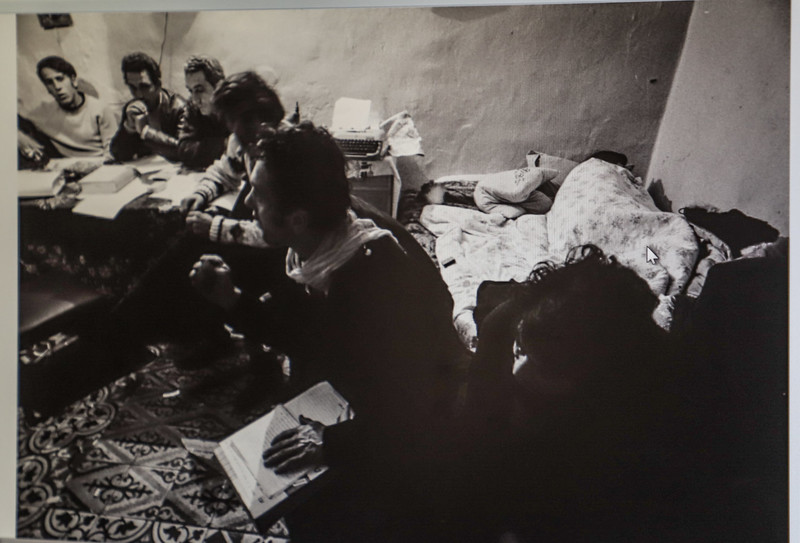 An old black and white photo shows young panthers meeting in Abergel's house in Musrara, the area where the group was founded. The room is small and there is a bed behind one of the group who appears to be speaking