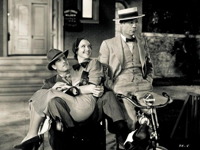 Джо Э. Браун, Максин Дойл и Гордон Вескотт на велосипеде с коляской. 1934 год.