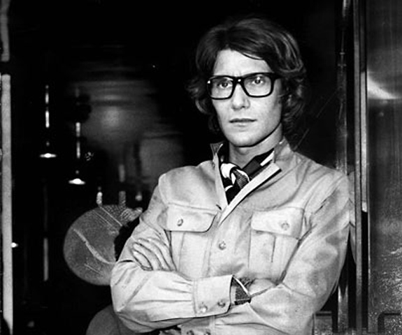 Yves St Laurent standing outside his first ready-to-wear boutique in Britain - St Laurent Rive Gauche.