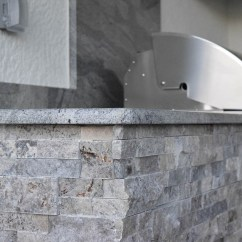 Stacked Stone Outdoor Kitchen Lighting For Island Waters Edge Kitchens In Bridgetown Elegant