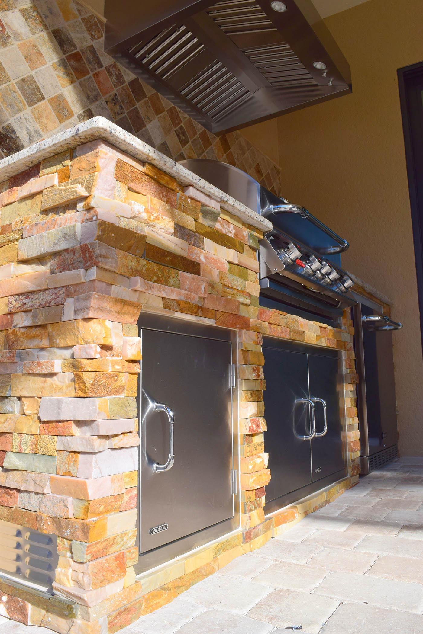 stacked stone outdoor kitchen composite sinks the elegant kitchens