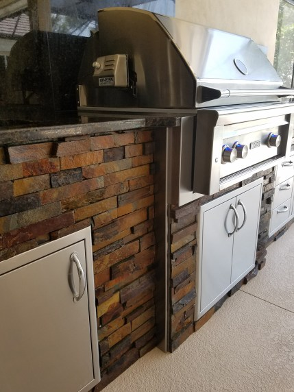 Custom Barbecue Island Construction by Elegant Outdoor Kitchens
