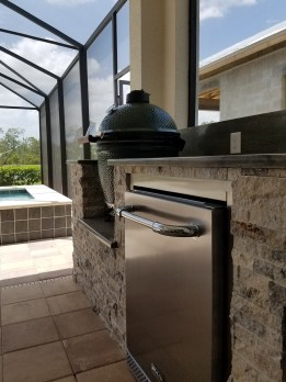 Outdoor Rated Refrigerator & Silver Travertine Stacked Stone Facade