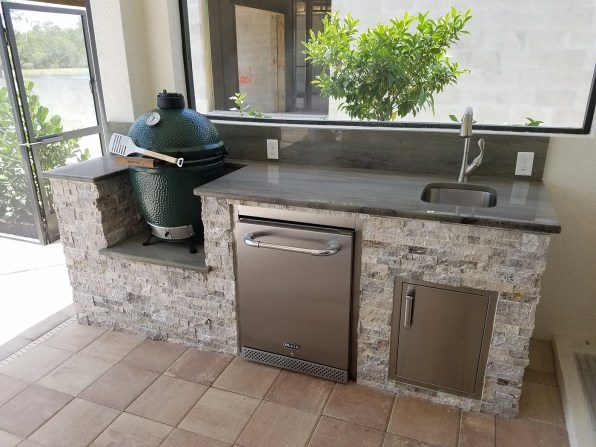 Silver Travertine Stacked Stone Facade and Gorgeous Upgraded Wild Sea Green Granite