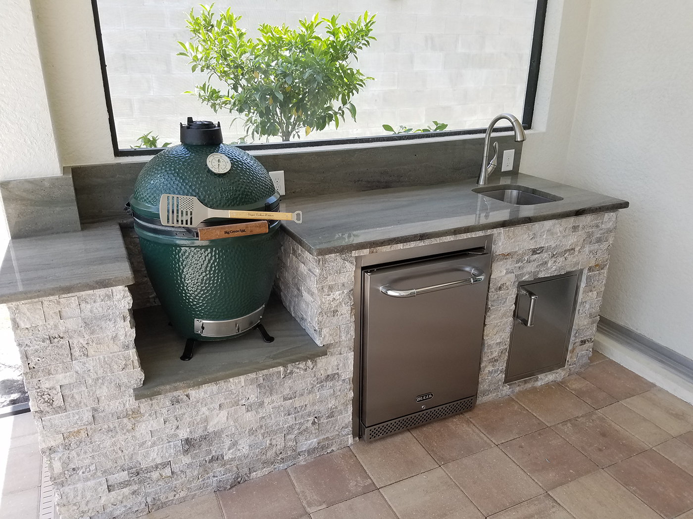stacked stone outdoor kitchen inexpensive countertops the big green egg elegant kitchens