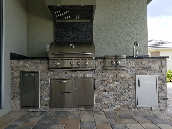 Front View of Custom Barbecue Island Build by Elegant Outdoor Kitchens