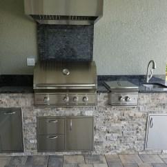 Stacked Stone Outdoor Kitchen White Faucet Hurricane Resistant Elegant Kitchens