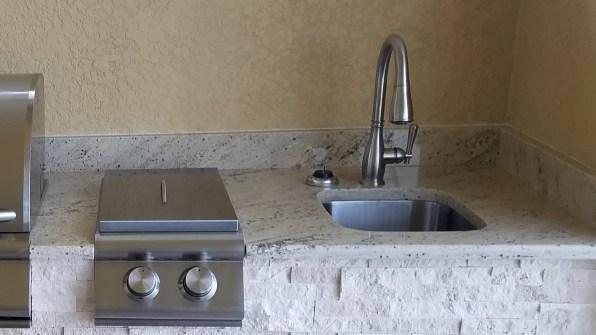 Close-up Faucet and Sideburner - Elegant Outdoor Kitchens