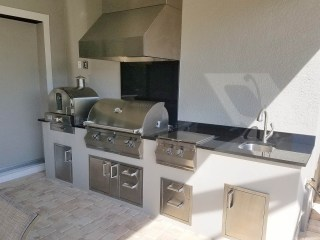 Stucco to Match with Absolute Black granite - Elegant Outdoor Kitchens