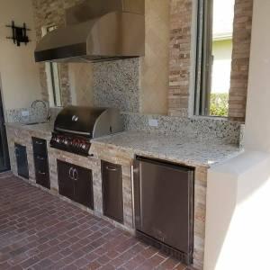 Custom Barbecue Island with Golden White Stacked Stone Façade, Classic Travertine Premium Tile, Verona level 1 Granite