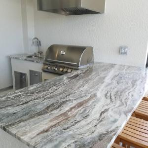 This Custom Barbecue Island was Finished Using Level 3 Ocean Beige Granite